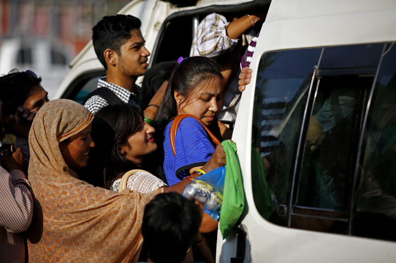 Passengers have a difficult time getting inside a public vehicle as fuel crisis